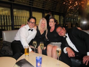 Kim Fay with her husband, Jim, and Susan MacNeal with her husband, Neal, in the Hyatt's bar after the awards.